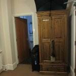 Armoire for hanging clothes and bathroom doorway
