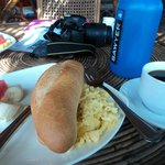 free breakfast baguette, scrambled eggs, fruit and coffee