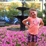 My daughter at the fountain in the back of the hotel.