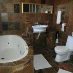 Bathroom with jet bath and shower