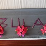 Welcome floral message on the bed