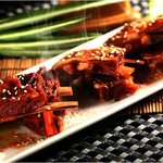 House Specialty of marinated XinJiang Lamb Ribs Grilled in Traditional Xinjiang Style
