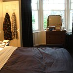 Room with king bed and daybed, insuite bath with shower and tub