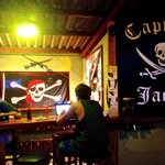A view of Captain Jack's at night, with the eponymous Captain seated on the left.