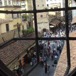 View out a window in the Vasari Corridor down onto the Ponte Vecchio