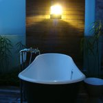 Outdoor bath - garden view room - at night