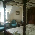 bedroom at lowerfield farm with four poster bed
