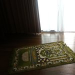 prayer mat , electric mosquito repellent among other basic amenities provided in the rooms