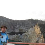 Writer with Kelimutu Crater at back ground