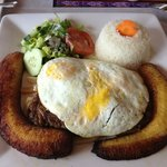 Steak with fries, plantains, rice and fried eggs