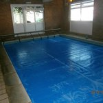 Indoor pool with pull back cover