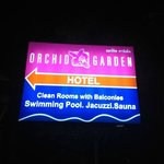 Hotel sign lighted at night