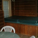 back deck with large hot tub
