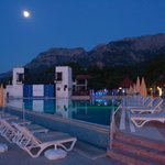 Pool area with mountains and moonlight