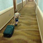 Boo!  Time to go home.  Our 3 year old rolling a suitcase down the hall.