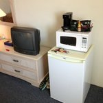 Fridge and microwave in room.