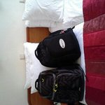 Trip Advisor backpack on bed!!