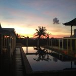 beautiful sunrise at rooftop pool