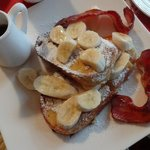Orange & vanilla flavoured French Toast with grilled bacon, bananas & maple syrup