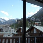 On the balcony overlooking the main street Zermatt with view of Matterhorn.