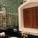 the mirror walled bath tub