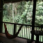 The bedroom opens out to the jungle! There is even a hammock to enjoy a nap in.