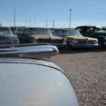 Cars line up in the lot outside