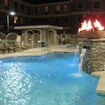 Beautiful Pool Area at Night with lit fire bowls