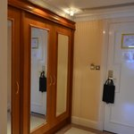 Entry hall to room with big closets