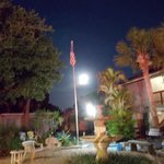 Sea Star Motel courtyard at night with full moon
