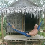Relaxing by the garden outside my bamboo hut