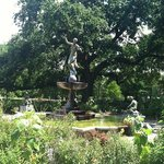 Charming statue and garden to sit and enjoy!