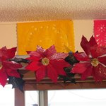 Poinsettias and colored doilies decorate the dining room.