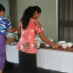 Ipu and one of the ladies of the house serving breakfast
