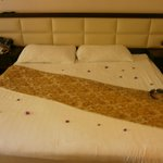 Bed made up with petals