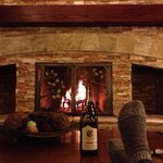 Feet up, comfy couch, crackling wood fire and wine. What 's not to love?