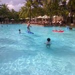 "vVew of Main pool with ""surfing"" activity being run by kids club"