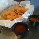 Housemade tortilla chips with refried beans and salsa