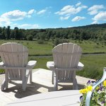 Adirondack chairs on the deck of the Carriage House