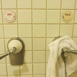 Useful shower faucet signage, reminded me of two smiley faces. great water pressure, and bath pr