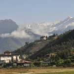 view of the himalayas from Paro airport with the Dzong