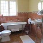 A very moder bathroom with separate shower