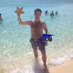 my friend caught this starfish while snorkeling in front of Plantana