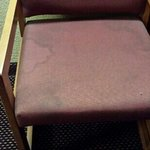 chair in room is stained and upholstry dried hard.