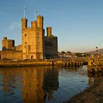 Sun setting on Caernarfon Castle