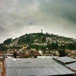 View of El Panecillo hill from rooftop terrace.