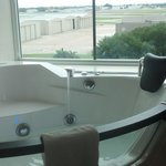 Jacuzzi tub overlooking airport