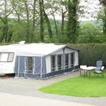 Fully Serviced, level hard standing Touring Pitch
