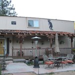 Front of the Kokopelli Inn, with patio and handmade outdoor fireplace.