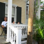 Hubby relaxing on Porch at the Eyebrow House Andrews Inn Cottage